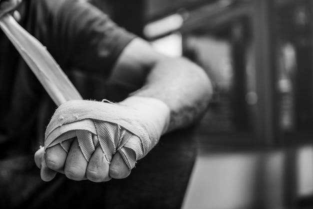 A mão do pugilista envolve o conceito da junta da proteção
