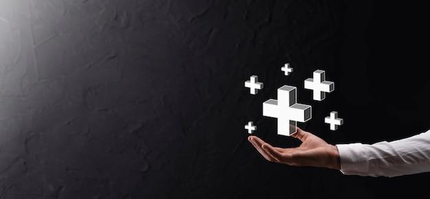 A mão segura 3d ícone de adição, a mão segura em mão oferece coisas positivas, como lucro, benefícios, desenvolvimento, csr representado pelo sinal de mais. a mão mostra o sinal de mais