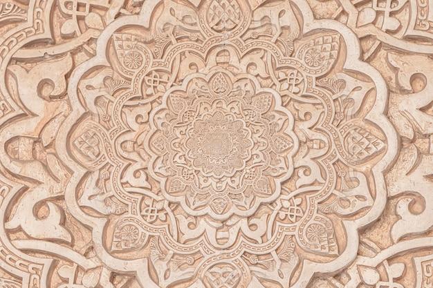 A origem árabe remete à cultura islâmica. design criado com efeito droste em um detalhe arquitetônico do século 13 em uma mesquita.