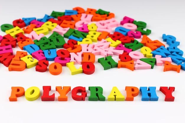 A palavra poligrafia com letras coloridas