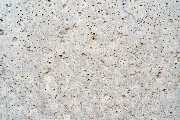 A parede áspera da casa. a textura do cimento.