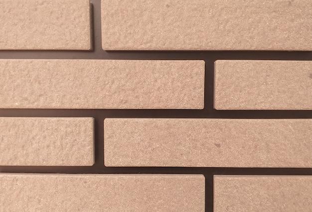 A parede de arenito é uma parede quadrada organizada em uma fileira. fundo. Foto Premium