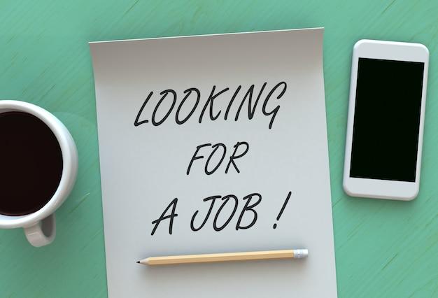 À procura de um emprego, mensagem em papel, telefone inteligente e café na mesa