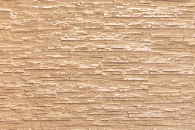 A superfície da parede tem a forma de uma pedra.