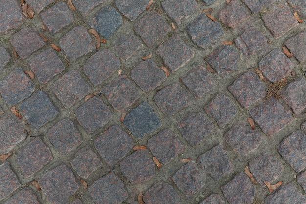 A superfície da pedra de pavimentação. vista do topo. fundo. espaço para texto.