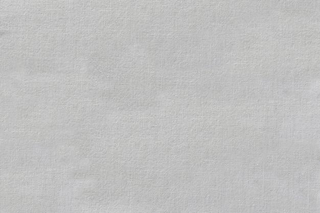 A superfície do tecido branco enruga o fundo para o pano de fundo do objeto de design.