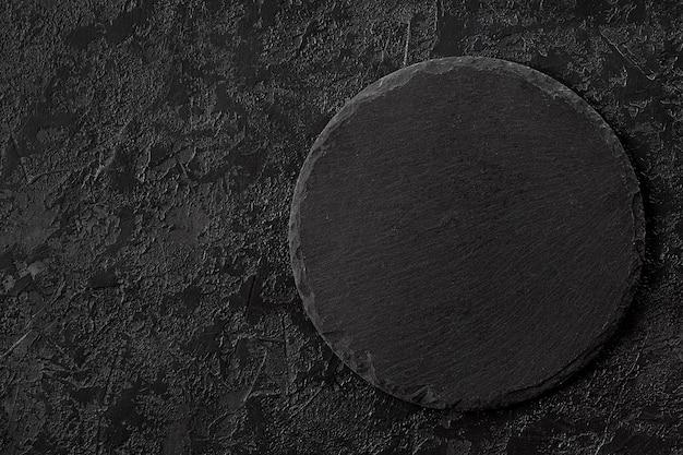 A textura concreta cinzenta escura pode ser usada para o fundo