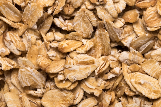 A textura da aveia. foto de flocos de aveia, fundo de aveia. foto de aveia, aveia seca, grãos de aveia