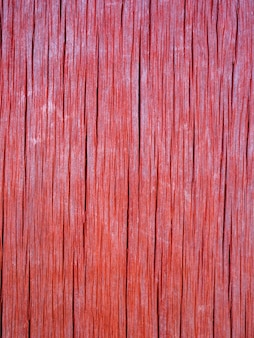 A textura da cor de coral velha placa de madeira