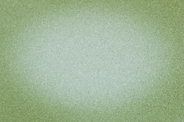 A textura da cor verde clara do granito com pontos pequenos, com vignetting, usa o fundo.