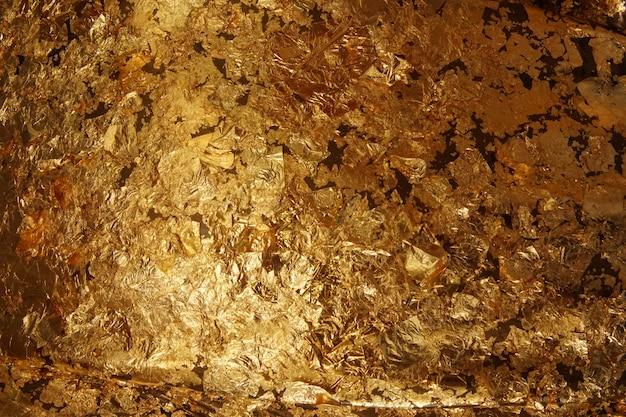 A textura da folha de ouro escuro.