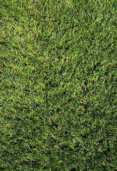 A textura da grama artificial verde. cobertura para estádios esportivos.