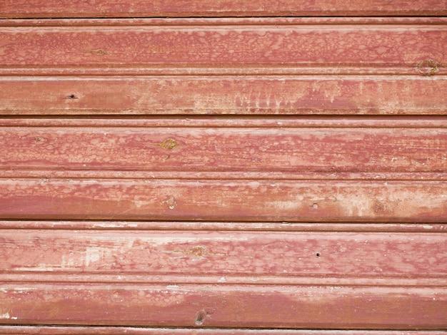 A textura da madeira velha vermelha