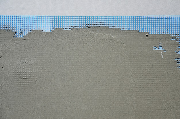 A textura da parede, coberta com placas de poliestireno espuma cinza