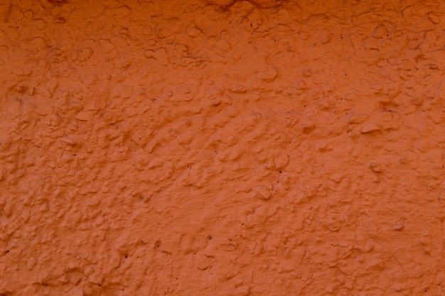 A textura da parede de concreto é cor de coral. um, gesso, parede, fundo