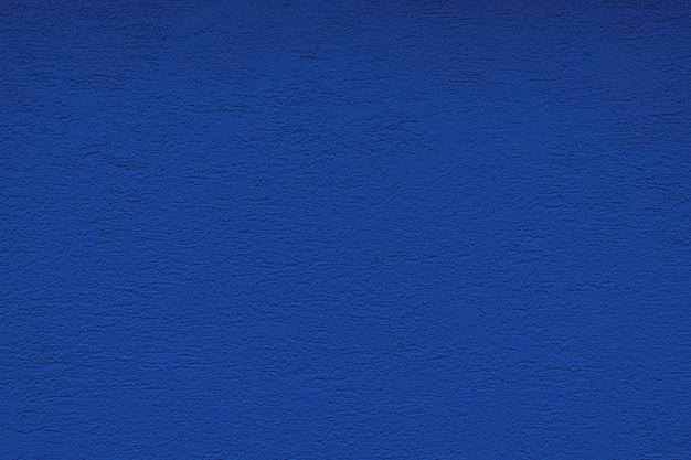 A textura da parede de gesso concreto da cor tendência azul. textura do conceito, reparação