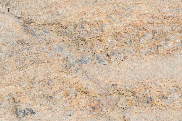 A textura da pedra com várias impregnações.