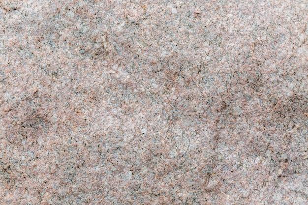 A textura da pedra de granito no exterior. fundo. fechar-se.