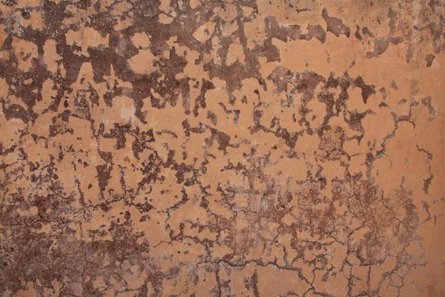 A textura da superfície da velha parede de cimento, fundos de parede de concreto marrom grunge
