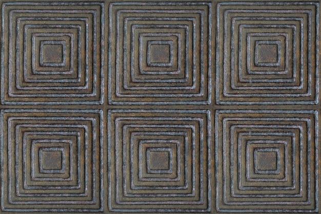 A textura da superfície do metal com um padrão em forma de quadrados e losangos de cor marrom.