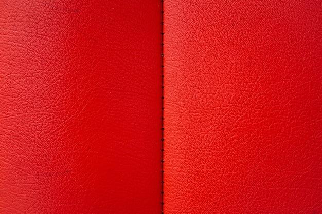 A textura de couro vermelho do sofá pode ser usada como plano de fundo