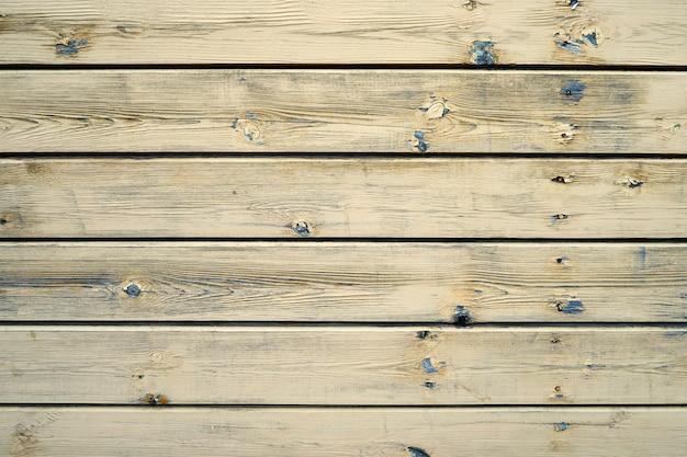 A textura de madeira amarela velha com padrões naturais. espaço da cópia