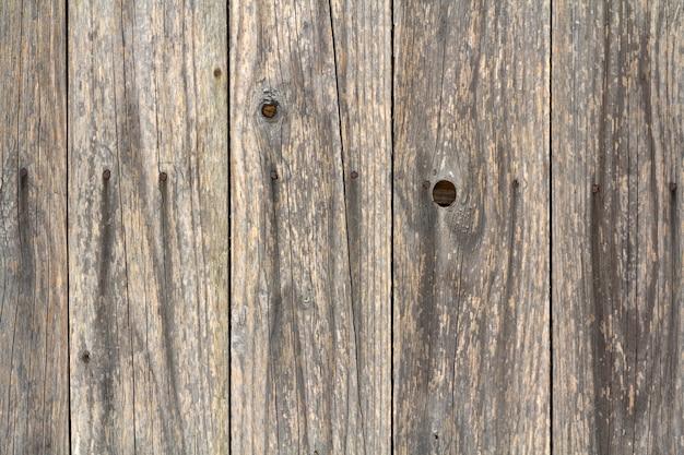 A textura de madeira do marrom escuro com teste padrão natural para o fundo, a superfície de madeira para adiciona o texto ou projeta o trabalho de arte da decoração.
