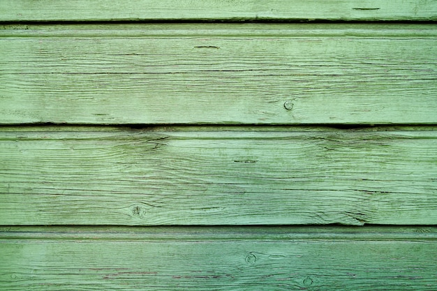 A textura de madeira verde velha com padrões naturais. espaço da cópia