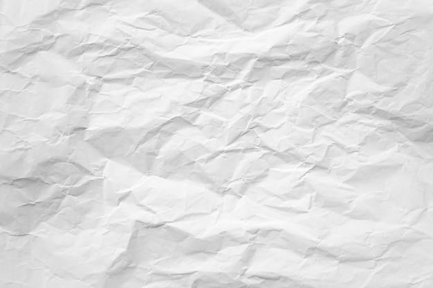 A textura de papel reciclado amassada branca pode ser usada como plano de fundo