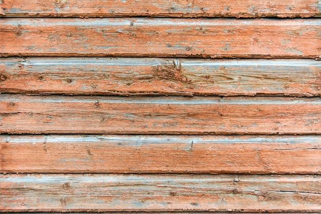 A textura de tábuas de madeira. uma cerca feita de tábuas. a parede da casa de madeira
