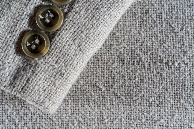 A textura de um denso tecido de lã branca. fundo de têxteis de close-up.