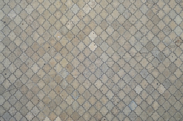 A textura de um mosaico rítmico feito de telhas de concreto.
