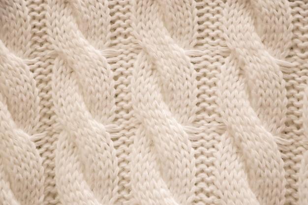 A textura de um suéter aconchegante de tricô. tricô, acessórios para casa.