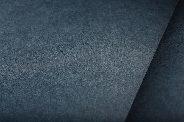 A textura de um tablet de página em branco preto para pastéis. fundo preto de textura de papel.
