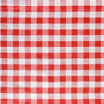 A textura de uma toalha de mesa quadriculada vermelha e branca