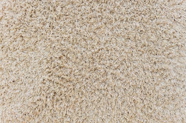 A textura do capacho sujo velho com seixo pequeno.