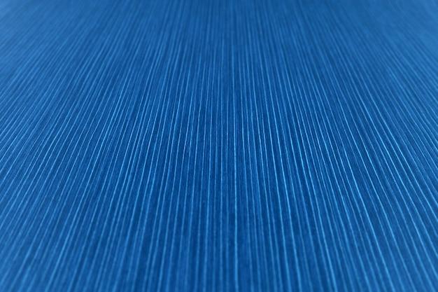 A textura do papel listrado em um tom de azul brilhante