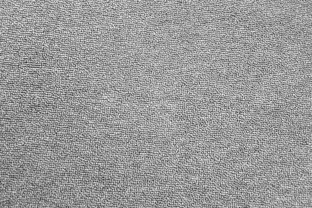 A textura do tapete cinza. o plano de fundo de pano cinza. vista do topo.