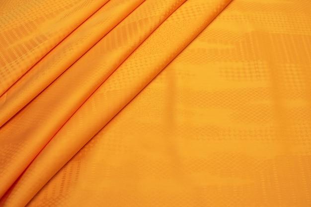 A textura do tecido de algodão é laranja.