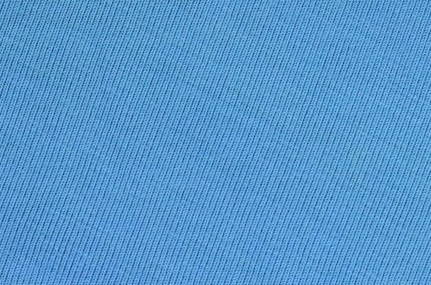A textura do tecido em fundo azul