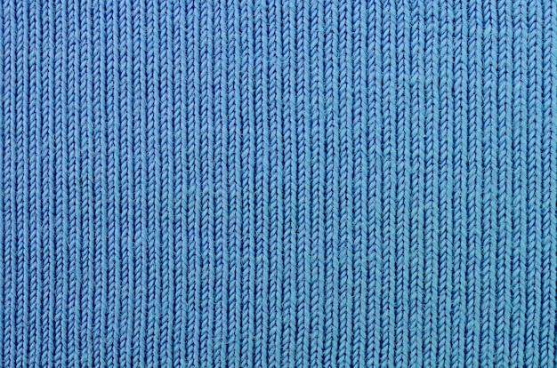A textura do tecido na cor azul. material para fazer camisas e blusas
