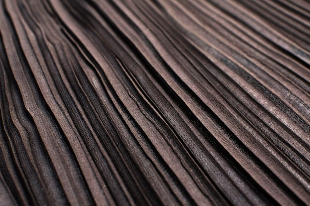 A textura do tecido sintético é marrom. plisse.