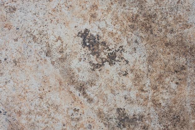 A textura do velho muro de concreto para o fundo