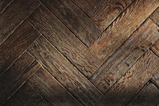 A textura do velho piso de madeira, o arranjo diagonal do parquet.
