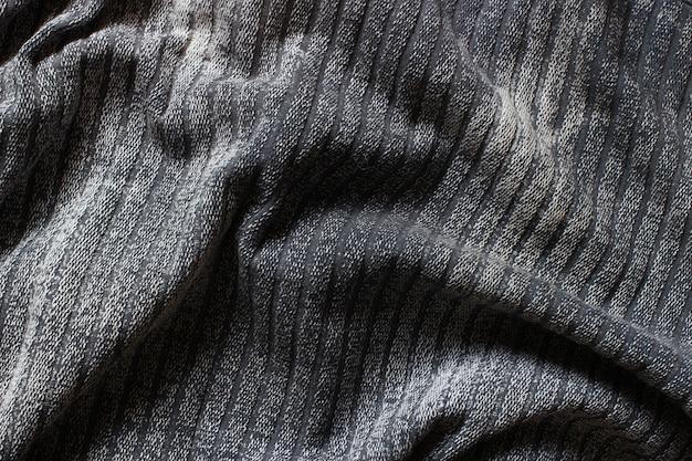 A textura é de tecido cinza