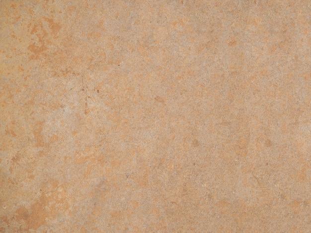A textura perfeita da parede de pedra amarela clara