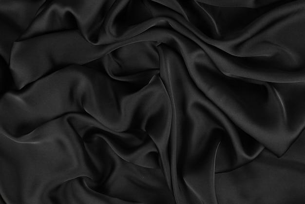 A textura suave e elegante de seda ou tecido luxuoso de cetim pode usar como plano de fundo do casamento. projeto luxuoso do plano de fundo.