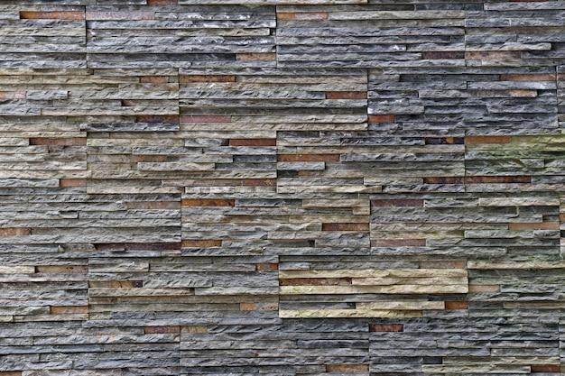A textura velha da parede de pedra no resistido e tem superfícies naturais.