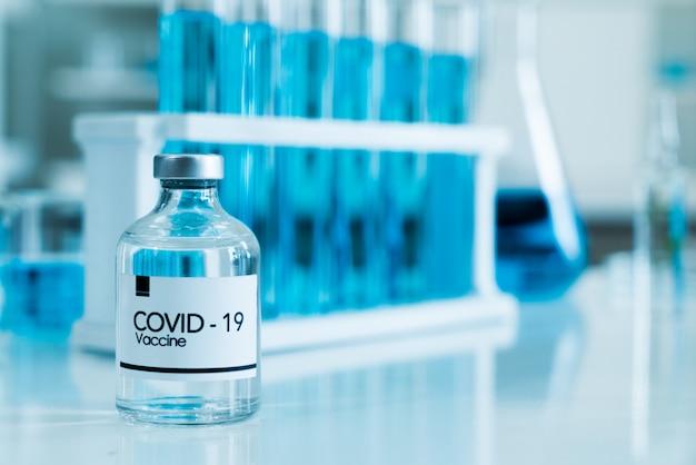 A vacina covid-19 no laboratório em segundo plano é um laboratório de ciências baseado no conceito coronavirus 2019.
