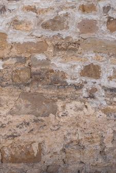 A velha parede é feita de pedras. textura e plano de fundo.